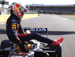 Red Bull driver Max Verstappen of the Netherlands leaves his car after finishing first in the Sprint Qualifying of the British Formula One Grand Prix, at the Silverstone circuit, in Silverstone, England, Saturday, July 17, 2021. The British Formula One Grand Prix will be held on Sunday. (Lars Baron/Poolvia AP)