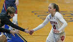 Indiana guard Nicole Cardano-Hillary is greeted by Indiana head coach Teri Moren during the second half of a college basketball game against Belmont in the second round of the women's NCAA tournament at the Greehey Arena in San Antonio on Wednesday, March 24, 2021. Indiana defeated Belmont 70-48. (AP Photo/Ronald Cortes)