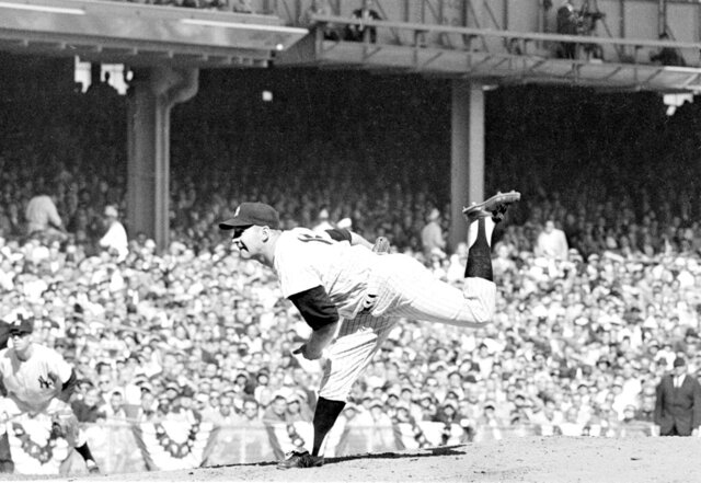 FILE - In this Oct. 8, 1960 file photo, New York Yankees pitcher Whitey Ford throws against the Pittsburgh Pirates in the third World Series game at Yankee Stadium in New York.  A family member tells The Associated Press on Friday, Oct. 9, 2020 that Ford died at his Long Island home Thursday night. (AP Photo, File)