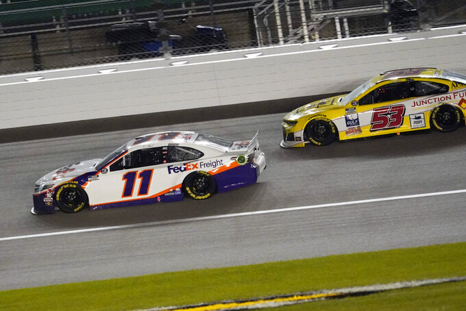 Denny Hamlin (11) battles Josh Bilicki (53) during a NASCAR Cup Series auto race at Kansas Speedway in Kansas City, Kan., Thursday, July 23, 2020. (AP Photo/Charlie Riedel)