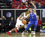 Fresno State's Deshon Taylor (21) drives as Air Force's Christopher Joyce (5) defends during the first half of an NCAA college basketball game in the Mountain West Conference men's tournament Thursday, March 14, 2019, in Las Vegas. (AP Photo/Isaac Brekken)