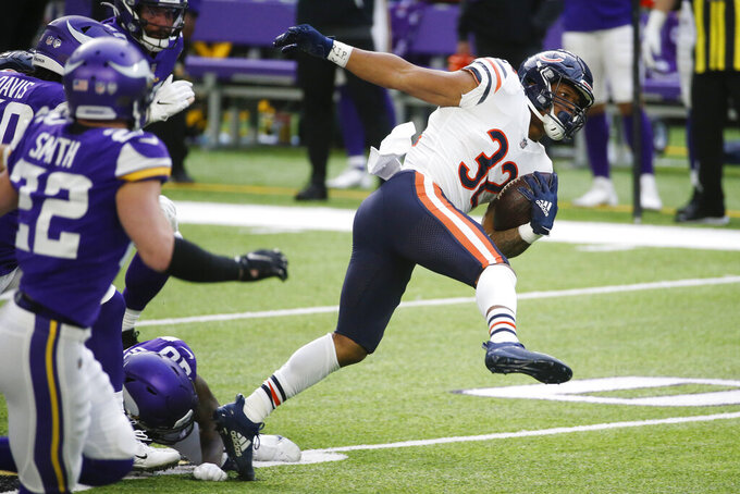 Chicago Bears running back David Montgomery (32) is tackled by Minnesota Vikings cornerback Jeff Gladney (20) during the first half of an NFL football game, Sunday, Dec. 20, 2020, in Minneapolis. (AP Photo/Bruce Kluckhohn)