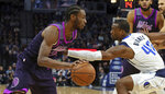 Minnesota Timberwolves' Andrew Wiggins, left, drives as Dallas Mavericks' Harrison Barnes defends in the first half of an NBA basketball game Friday, Jan. 11, 2019, in Minneapolis. (AP Photo/Jim Mone)
