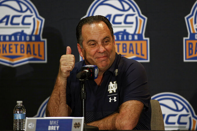 FILE - In this Oct. 8, 2019, file photo, Notre Dame coach Mike Brey answers a question during the Atlantic Coast Conference NCAA college basketball media day in Charlotte, N.C. As long as John Mooney keeps putting up double-doubles and his teammates stay healthy, Brey feels pretty good about Notre Dame's chances this season. (AP Photo/Nell Redmond, File)