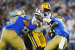 UCLA quarterback Dorian Thompson-Robinson, right, is sacked by LSU defensive end Andre Anthony (3) during the first half of an NCAA college football game Saturday, Sept. 4, 2021, in Pasadena, Calif. (AP Photo/Marcio Jose Sanchez)