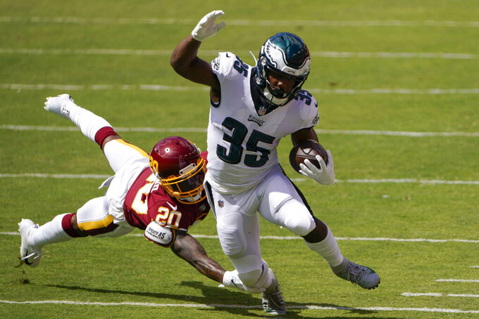 Philadelphia Eagles running back Boston Scott (35) breaks away from a tackle from Washington Football Team cornerback Jimmy Moreland (20) during the first half of an NFL football game, Sunday, Sept. 13, 2020, in Landover, Md. (AP Photo/Susan Walsh)