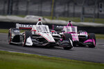 Josef Newgarden leads Jack Harvey, of England, into a turn an IndyCar auto race at Indianapolis Motor Speedway in Indianapolis, Saturday, Oct. 3, 2020. (AP Photo/Michael Conroy)