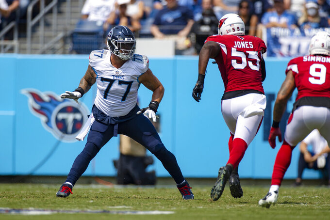 FILE - In this Sept. 12, 2021, file photo, Tennessee Titans offensive tackle Taylor Lewan (77) defends against against Arizona Cardinals linebacker Chandler Jones (55) during the first half of an NFL football game in Nashville, Tenn. Lewan says he didn't deal well with his first game back after the first injury of his career, getting so amped up the three-time Pro Bowler was drained by kickoff. That led to one of the worst performances of his career. Lewan was victimized repeatedly by Jones, who finished the game with five sacks and two forced fumbles.(AP Photo/Brett Carlsen, File)