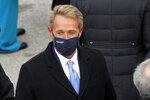 FILE - In this Jan. 20, 2021, file photo, former Arizona Sen. Jeff Flake arrives for the inauguration of President-elect Joe Biden during the 59th Presidential Inauguration at the U.S. Capitol in Washington. Arizona Republicans voted Saturday, Jan. 23, 2021 to censure Cindy McCain and two prominent GOP officials who have found themselves crosswise with former President Donald Trump. Party activists also reelected controversial Chairwoman Kelli Ward, who has been one of Trump's most unflinching supporters and among the most prolific promoters of his baseless allegations of election fraud. The censures of Sen. John McCain's widow, former Sen. Jeff Flake and Gov. Doug Ducey are merely symbolic. (AP Photo/Andrew Harnik, File)