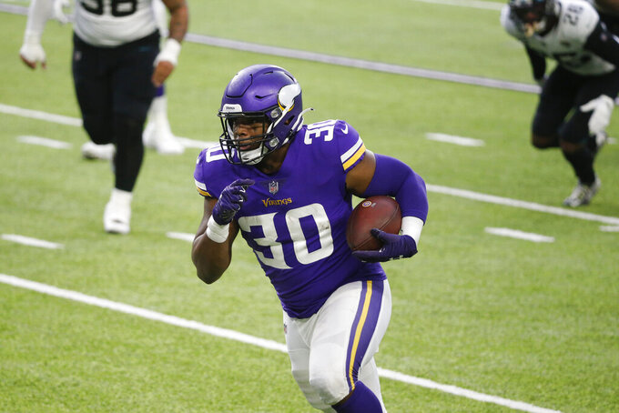 Minnesota Vikings fullback C.J. Ham scores on a 12-yard touchdown reception during the second half of an NFL football game against the Jacksonville Jaguars, Sunday, Dec. 6, 2020, in Minneapolis. (AP Photo/Bruce Kluckhohn)