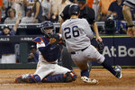 New York Yankees' DJ LeMahieu is tagged out by Houston Astros catcher Robinson Chirinos who tried to score on a single by Brett Gardner during the sixth inning in Game 2 of baseball's American League Championship Series Sunday, Oct. 13, 2019, in Houston. (AP Photo/Eric Gay)