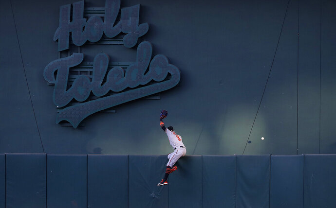 Baltimore Orioles center fielder Keon Broxton cannot catch a solo home run hit by Oakland Athletics' Beau Taylor during the third inning of a baseball game in Oakland, Calif., Tuesday, June 18, 2019. (AP Photo/Jeff Chiu)