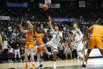 Hawaii guard Drew Buggs (1) makes a shot over UTEP during the second half of an NCAA college basketball game Sunday, Dec. 22, 2019, in Honolulu. Hawaii defeated UTEP 67-63 advancing to the semifinals of the tournament. (AP Photo/Marco Garcia)