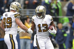 New Orleans Saints' Michael Thomas (13) is congratulated by Josh Hill on his touchdown against the Seattle Seahawks during the second half of an NFL football game Sunday, Sept. 22, 2019, in Seattle. (AP Photo/Scott Eklund)