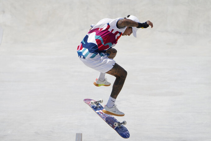 Nyjah Huston of the United States competes during the men's street skateboarding finals at the 2020 Summer Olympics, Sunday, July 25, 2021, in Tokyo, Japan. (AP Photo/Jae C. Hong)
