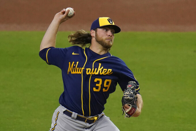 Milwaukee Brewers starting pitcher Corbin Burnes works against a San Diego Padres batter during the first inning of a baseball game Tuesday, April 20, 2021, in San Diego. (AP Photo/Gregory Bull)