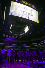 A tribute to NBA basketball player Kobe Bryant and his daughter Gianna is played at Target Center before an NBA basketball game between Minnesota Timberwolves and the Sacramento Kings during an NBA basketball game Monday, Jan. 27, 2020, in Minneapolis. (AP Photo/Craig Lassig)