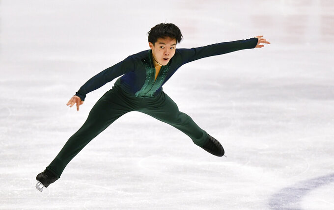 Yuma Kagiyama of Japan performs during the Men Free Skating Program at the Figure Skating World Championships in Stockholm, Sweden, Saturday, March 27, 2021. (AP Photo/Martin Meissner)
