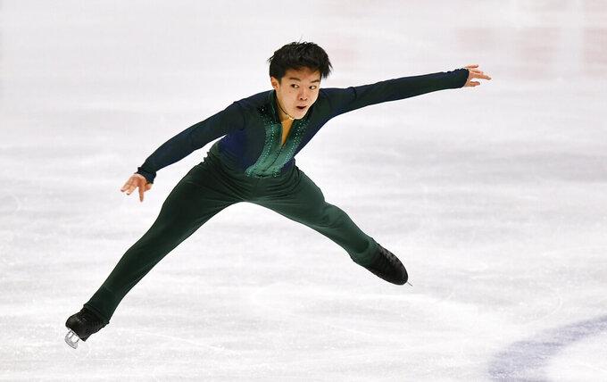 Chen wins 3rd straight worlds, beating Olympic champ Hanyu