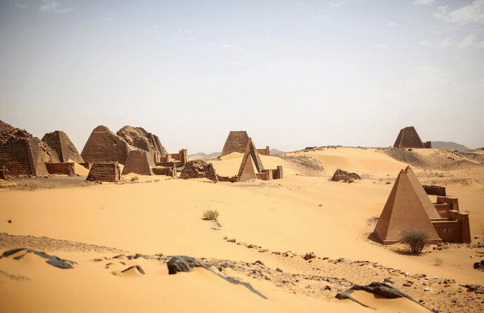 FILE - This April 16, 2015 file photo, shows a general view of the historic Meroe pyramids site, in al-Bagrawiya, 200 kilometers (125 miles) north of Khartoum, Sudan.  A leading archaeologist says the floodwaters have already entered the ancient royal city of the Kushite kings known as the Island of Meroe, a UNESCO World Heritage site.  .(AP Photo/Mosa'ab Elshamy)