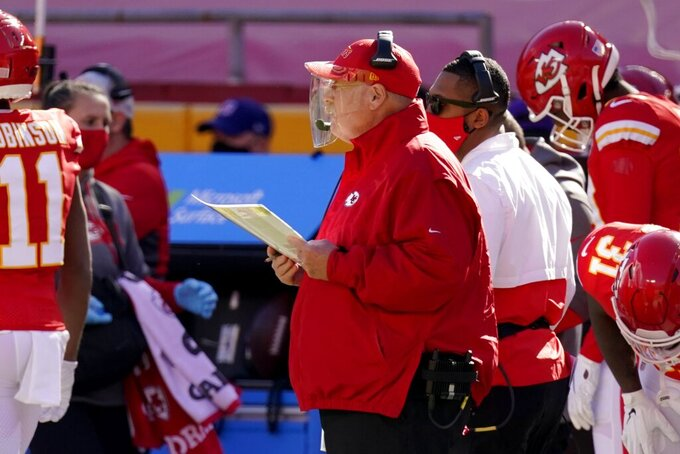 Kansas City Chiefs head coach Andy Reid, center, watches play against the New York Jets in the first half of an NFL football game on Sunday, Nov. 1, 2020, in Kansas City, Mo. (AP Photo/Charlie Riedel)