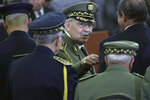 FILE - In this photo taken Thursday, Dec. 19, 2019, Algerian military chief Gaid Salah attends president Abdelmajid Tebboune's inauguration ceremony in the presidential palace, in Algiers, Algeria, Algerian state media says the country's powerful military chief Gen. Ahmed Gaid Salah has died. Algerian government radio says he died Monday morning in the military hospital of Algiers after a heart attack. Gaid Salah was seen as the main power player in Algeria since he and a pro-democracy movement pushed out the country's longtime president in Apri (AP Photo/Fateh Guidoum, File)