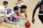 Northwestern guard Eric Zalewski, left, and Nebraska guard Kobe Webster battle for a loose ball during the first half of an NCAA college basketball game in Evanston, Ill., Sunday, March 7, 2021. (AP Photo/Nam Y. Huh)