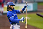 Toronto Blue Jays' Bo Bichette applies bat grip spray while preparing in the on-deck circle prior to his first inning at bat during a baseball game against the Boston Red Sox at Fenway Park, Monday, June 14, 2021, in Boston. (AP Photo/Charles Krupa)