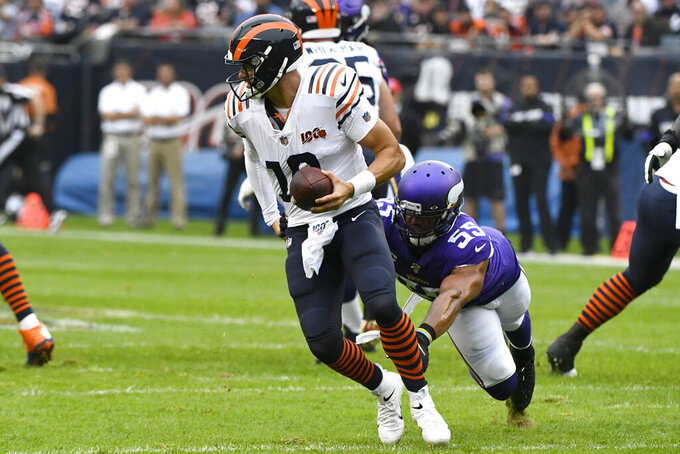 Chicago Bears quarterback Mitchell Trubisky (10) scrambles away from Minnesota Vikings outside linebacker Anthony Barr (55) during the half of an NFL football game Sunday, Sept. 29, 2019, in Chicago. (AP Photo/Matt Marton)