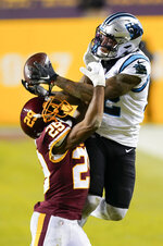 Washington Football Team cornerback Kendall Fuller (29) stops Carolina Panthers wide receiver D.J. Moore (12) from making a catch during the second half of an NFL football game, Sunday, Dec. 27, 2020, in Landover, Md. (AP Photo/Susan Walsh)