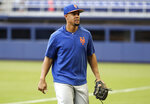 New York Mets' outfielder Carlos Gomez walks on the field before a baseball game against the Miami Marlins, Friday, May 17, 2019, in Miami. New York selected Gomez's contract from Triple-A Syracuse and have him batting sixth and in right field against the Marlins on Friday. (AP Photo/Lynne Sladky)