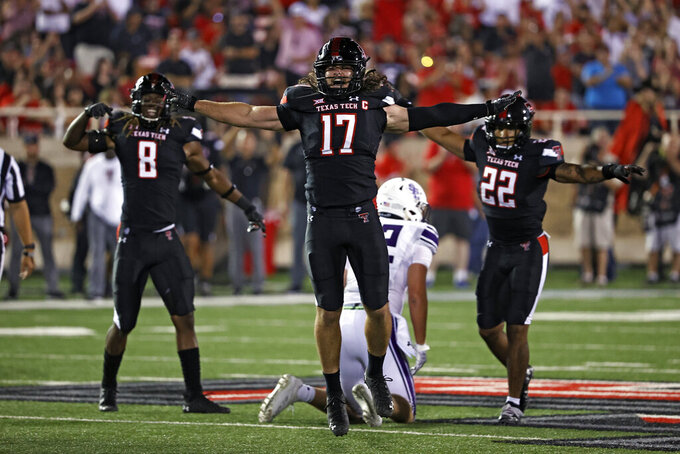 Texas Tech's Colin Schooler (17) celebrates after breaking up a Stephen F. Austin pass during the second half of an NCAA college football game Saturday, Sept. 11, 2021, in Lubbock, Texas. (AP Photo/Brad Tollefson)