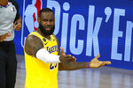 LeBron James of the Los Angeles Lakers reacts to a call against the Oklahoma City Thunder during the second half of an NBA basketball game Wednesday, Aug. 5, 2020, in Lake Buena Vista, Fla. (Kevin C. Cox/Pool Photo via AP)