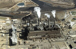 FILE - This Nov. 9, 2009, file photo shows the coal-fired San Juan Generating Station near Farmington, N.M. The parent company of New Mexico's largest electric utility will become part of energy giant Iberdrola's global holdings under a multibillion-dollar merger. Under the agreement announced Wednesday, Oct. 21, 2020, Iberdrola's majority-owned U.S. subsidiary Avangrid will acquire PNM Resources and its assets in New Mexico and Texas. The merger will require approval from a number of state and federal regulators in a process that's expected to take the next 12 months. (AP Photo/Susan Montoya Bryan, File)