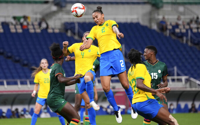 Brazil's Poliana, top, heads the ball during a women's soccer match against Zambia at the 2020 Summer Olympics, Tuesday, July 27, 2021, in Saitama, Japan. (AP Photo/Martin Mejia)