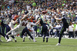 Seattle Seahawks punter Michael Dickson (4) kicks as Cincinnati Bengals defensive end Sam Hubbard (94) attempts the block during the first half of an NFL football game Sunday, Sept. 8, 2019, in Seattle. (AP Photo/Stephen Brashear)