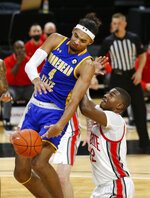 Morehead State forward Johni Broome (4) loses the ball against Ohio State forward E.J. Liddell during the first half of an NCAA college basketball game in Columbus, Ohio, Wednesday, Dec. 2, 2020. (AP Photo/Paul Vernon)