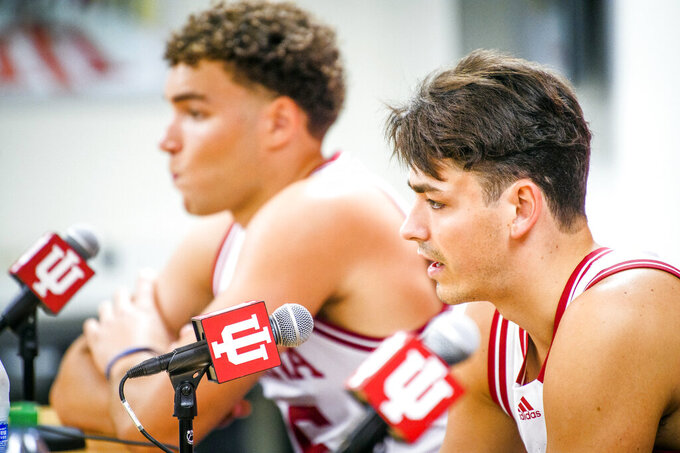 Indiana's Trey Galloway, right, answers questions during the program's NCAA college basketball media day in Bloomington, Ind., Monday, Sept. 27, 2021. (Rich Janzaruk/The Herald-Times via AP)