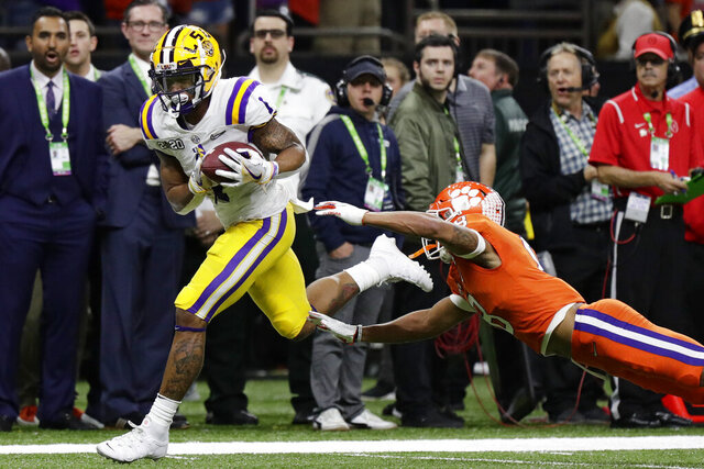 FILE - In this Jan. 13, 2020, file photo, LSU wide receiver Ja'Marr Chase scores past Clemson cornerback A.J. Terrell during the first half of a NCAA College Football Playoff national championship game, in New Orleans. Chase was selected to The Associated Press preseason All-America first-team, Tuesday, Aug. 25, 2020. (AP Photo/Sue Ogrocki, File)
