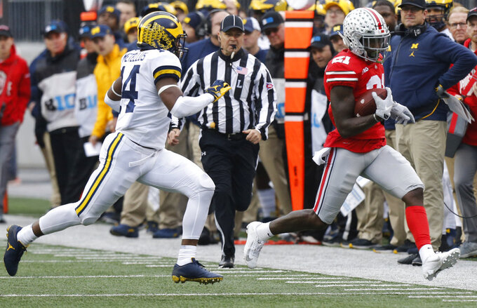 Michigan defensive back Josh Metellus, left, runs Ohio State receiver Parris Campbell out-of-bounds during the first half of an NCAA college football game Saturday, Nov. 24, 2018, in Columbus, Ohio. (AP Photo/Jay LaPrete)