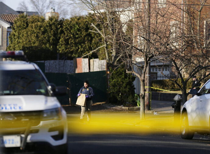 Police work near the scene where an alleged leader of the Gambino crime family was shot and killed in the Staten Island borough of New York, Thursday, March 14, 2019.  Francesco