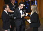 FILE - In this June 12, 2016 file photo Barbra Streisand, right, presents the award for best musical to Lin-Manuel Miranda, center, of
