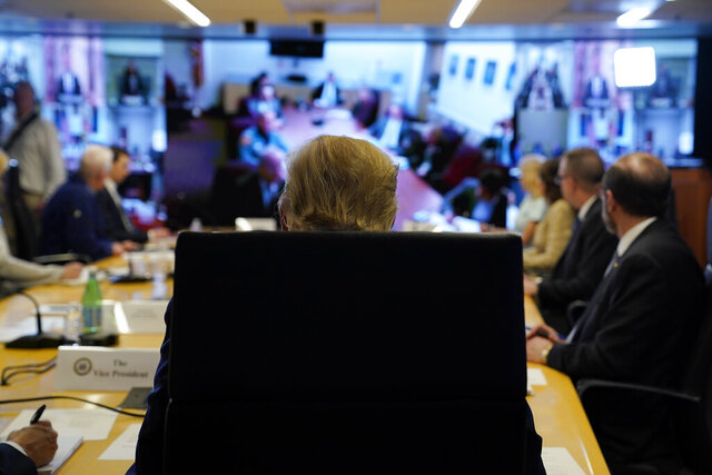 FILE - In this March 19, 2020, file photo President Donald Trump attends a teleconference with governors at the Federal Emergency Management Agency headquarters in Washington. Trump has framed his fight against the pandemic as a war, and himself a wartime president. But rather than fully lever the power of the federal government, he has increasingly put responsibility on the states, reigniting the kind of tension the nation's founders wrestled with more than two centuries ago. (AP Photo/Evan Vucci, Pool, File)