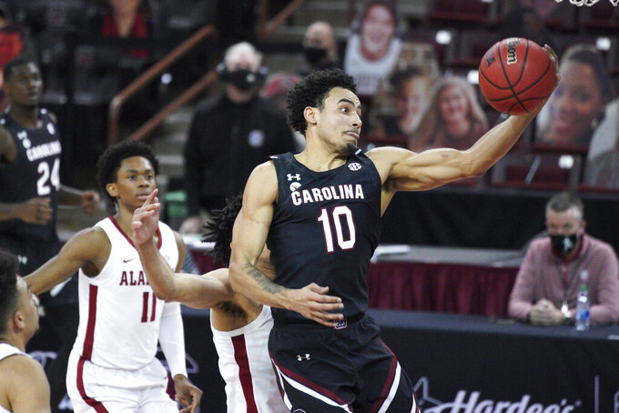 South Carolina forward Justin Minaya (10) drives to the hoop during the first half of an NCAA college basketball game against Alabama Tuesday, Feb. 9, 2021, in Columbia, S.C. (AP Photo/Sean Rayford)