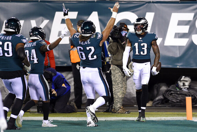 Philadelphia Eagles' Travis Fulgham (13) celebrates with teammates after catching a touchdown pass during the second half of an NFL football game against the Dallas Cowboys, Sunday, Nov. 1, 2020, in Philadelphia. (AP Photo/Derik Hamilton)