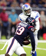 Detroit Lions quarterback Josh Johnson (4) fumbles the ball as he is hit by Houston Texans outside linebacker Whitney Mercilus (59) during the first half of an NFL preseason football game Saturday, Aug. 17, 2019, in Houston. The Lions recovered the fumble. (AP Photo/Michael Wyke)