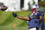 New England Patriots outside linebacker Dont'a Hightower tosses the ball during an NFL football practice, Wednesday, Oct. 13, 2021, in Foxborough, Mass. (AP Photo/Steven Senne)