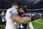 Detroit Lions offensive tackle Taylor Decker, left, hugs Dallas Cowboys running back Ezekiel Elliott (21) after an NFL football game, Sunday, Nov. 17, 2019, in Detroit. (AP Photo/Paul Sancya)