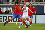 U.S. midfielder Rose Lavelle (16) moves the ball past Costa Rica defender Stephannie Blanco, left, during the first half of an international friendly soccer match Sunday, Nov. 10, 2019, in Jacksonville, Fla. (AP Photo/John Raoux)