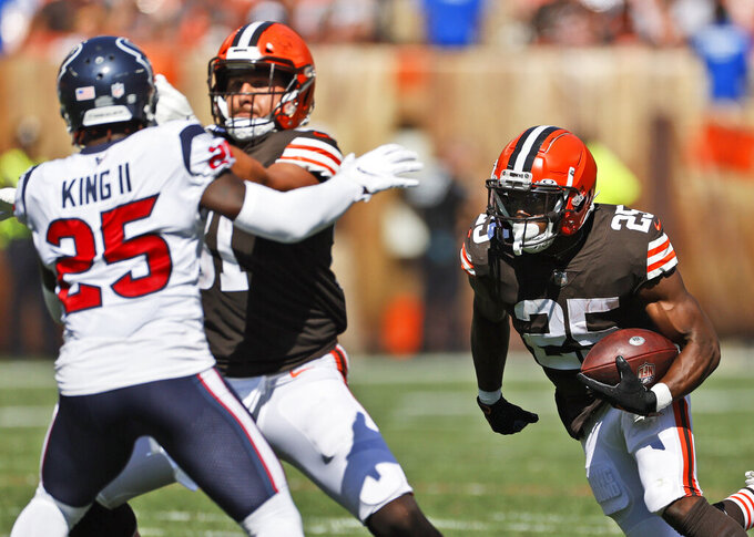 Cleveland Browns running back Demetric Felton (25) scores a 33-yard touchdown during the second half of an NFL football game against the Houston Texans, Sunday, Sept. 19, 2021, in Cleveland. (AP Photo/Ron Schwane)